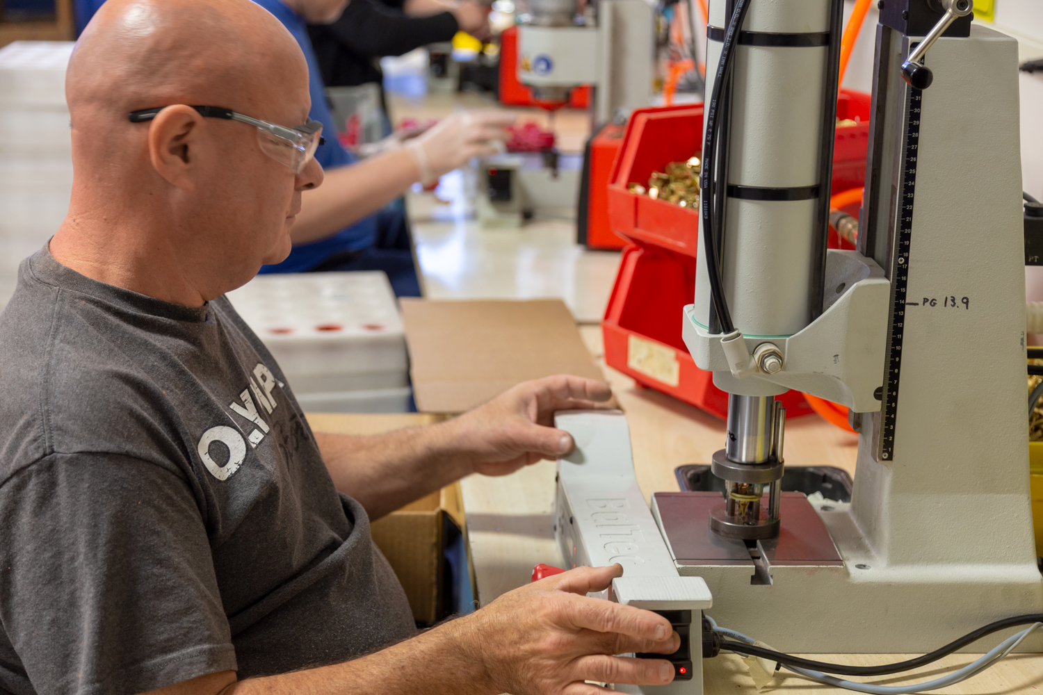 A worker is operating a machine at Alternatives Industry.