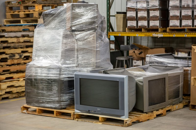 E-Waste at Alternatives Industry - Old Television Sets on a wooden pallet