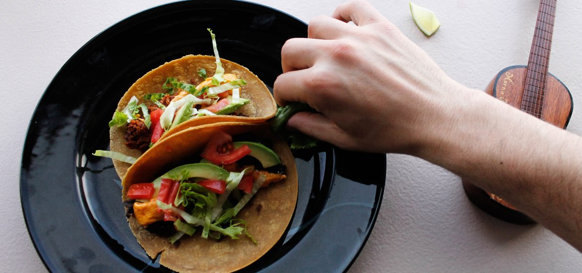 Tacos with hand and guitar