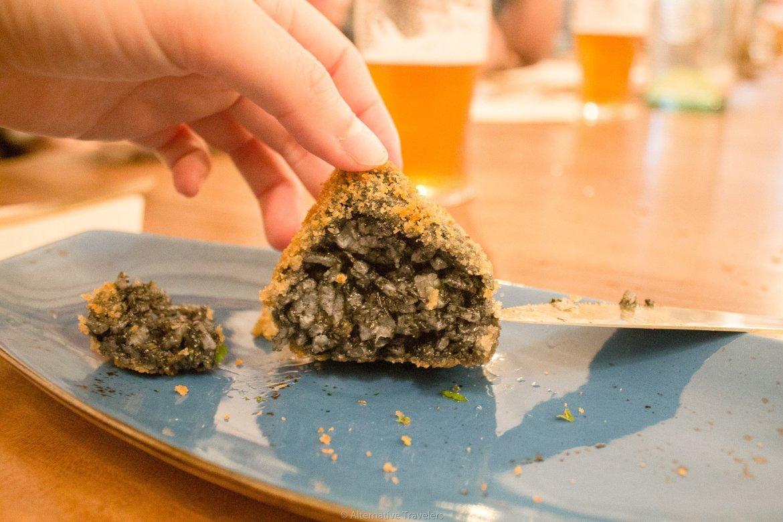 Close up of Arancinis de la Nonna at La Tia Carlota, a vegan gastrobar in Madrid, Spain   AlternativeTravelers.com
