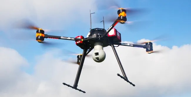 Drone aerial surveillance with infrared and HD video cameras with zoom