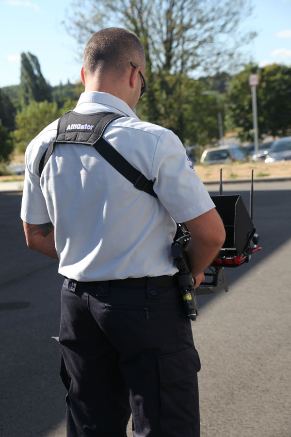 Police officer operating with drone