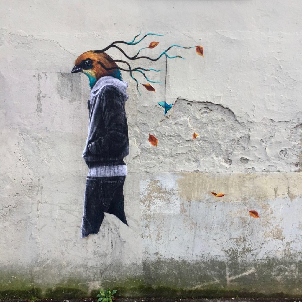 Homme à tête d'oiseau réalisé par le Street Artiste Parvati à Lyon