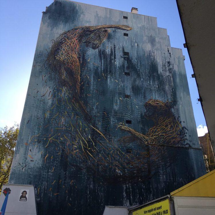 Boulevard Paris 13 - Fresque munmentale - jungle urbaine avec tigre réalisée par le Street Artiste DALeast à Paris