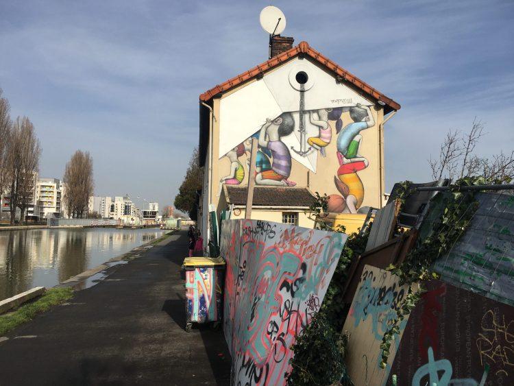 Fresque murale peinte par l'artiste Seth Globepainter au bord du Canal Saint Denis