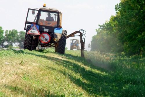 Ignored Hazard on Highways: Mowing Tractors