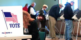 Voters in a voting booth_Election Day