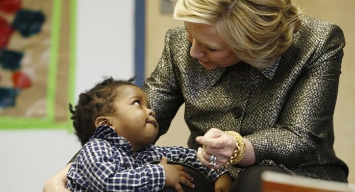 Hillary Clinton with little boy