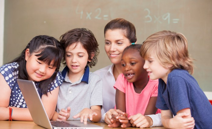 students in classroom with tech internet