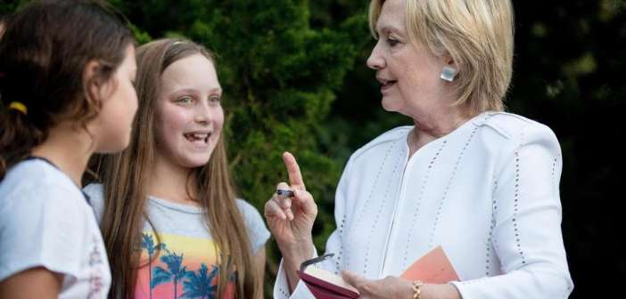 Hillary Clinton with young girls