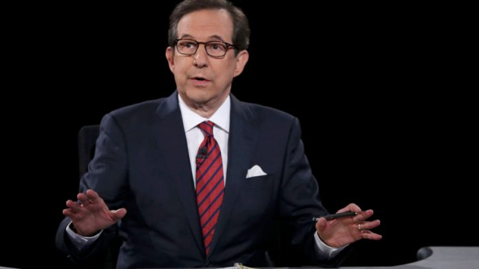 Debate moderator Chris Wallace speaks to Trump and Clinton during their third and final 2016 presidential campaign debate at UNLV in Las Vegas
