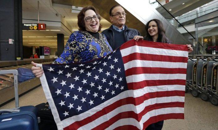 Holding American flag