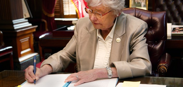 Kay Ivey Signing
