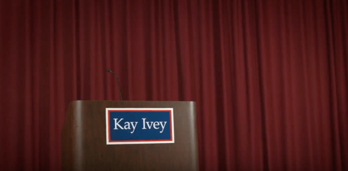 Kay Ivey empty podium