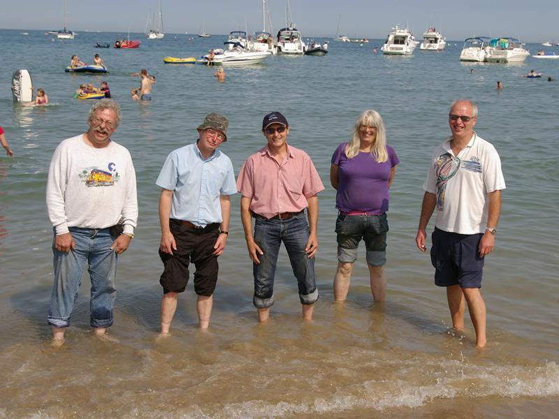 Members at the beach – from left, Richard Pretious, John Coates, Steve Cook, Diane Kivi, Graham Smith