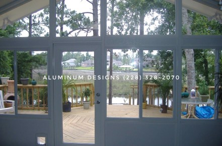 sunrooms with Glass windows and full view glass door built by Aluminum Designs of Saucier, MS.