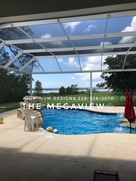 Another view of the same enclosure. This mansard style swimming pool enclosure is called a Megaview. It features structural post and beams allowing for a wide span between post. It has aluminum framing with 20/20 gnat proof screen. This pool enclosure is built by Aluminum Designs of Saucier, MS.