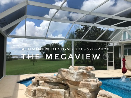 This mansard style swimming pool enclosure is called a Megaview. It features structural post and beams allowing for a wide span between post. It has aluminum framing with 20/20 gnat proof screen. This pool enclosure is built by Aluminum Designs of Saucier, MS.