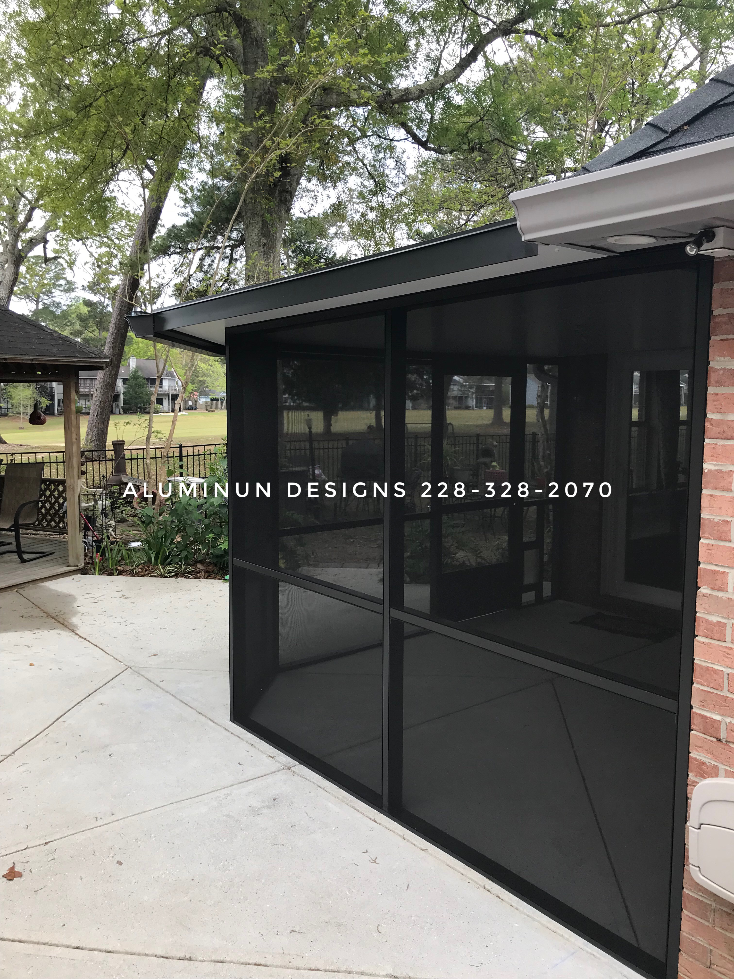 Insulated roof with screened patio eclosure from Aluminum Designs of Saucier, MS.