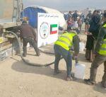 """""""الهلال الأحمر"""" يوزع 30 ألف لتر من وقود التدفئة على نازحي الموصل"""