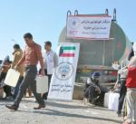 """""""الهلال الأحمر"""" توزع 30 ألف لتر من النفط على النازحين العراقيين في اربيل"""