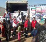الهلال الأحمر يوزع مساعدات على ألف أسرة سورية نازحة بلبنان
