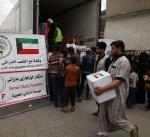 الهلال الأحمر توزع 2500 سلة غذائية في الجانب الايمن من الموصل