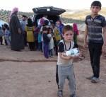 """""""النجاة الخيرية"""" توزع وجبات إفطار صائم على اللاجئين السوريين بالأردن"""
