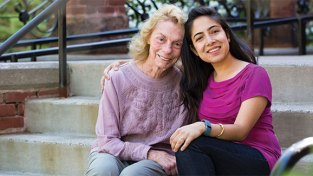 Dana Whyte '60 and Sandhya Banskota '10 reconnect during Reunion