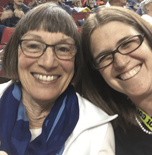 Margaret (Meg) Conkey '65 (left) and Jenny Simon-O'Neill '02 (right) at the Pac-12 women's basketball tournament