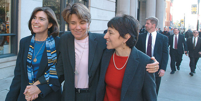 Ellen Wade '70 (left) and Maureen Brodoff celebrated their marriage in 2004; Bottom: Wade (right) with fellow plaintiffs in the case that legalized same-sex marriage in Massachusetts.