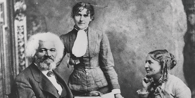 Frederick Douglass with Helen Pitts Douglass (seated, right) and her sister Eva Pitts (standing, center).