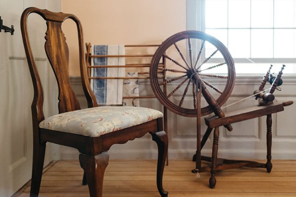 Spinning wheel and chair in Sycamores