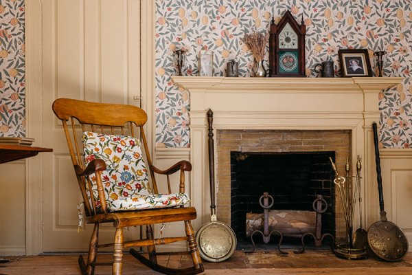 Rocking chair and fireplace at Sycamores