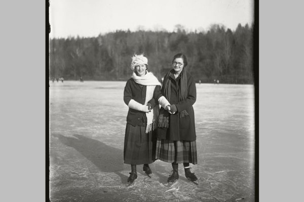 Helen Larrabee, class of 1923, and Ruth Guppy, class of 1921, skate arm in arm.