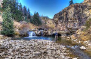 A man fishing in a Utah stream
