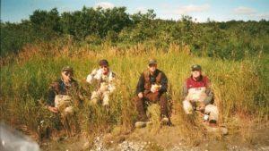 Four fly fishermen having lunch on the banks of the Kvichak River in Alaska