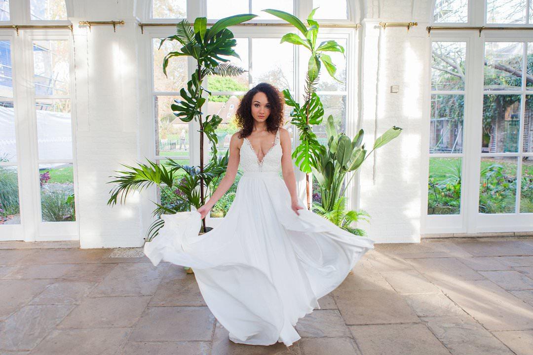 bride twirling her weddign dress troprical wedding inspiration shoot trend