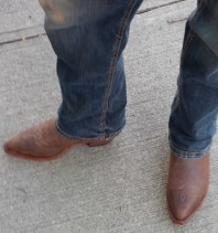 Picture of the young man's cowboy boots