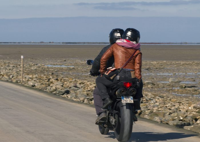France, Vendee, bikers crossing the Passage du Gois, submersible road connecting the mainland to the island of Noirmoutier.