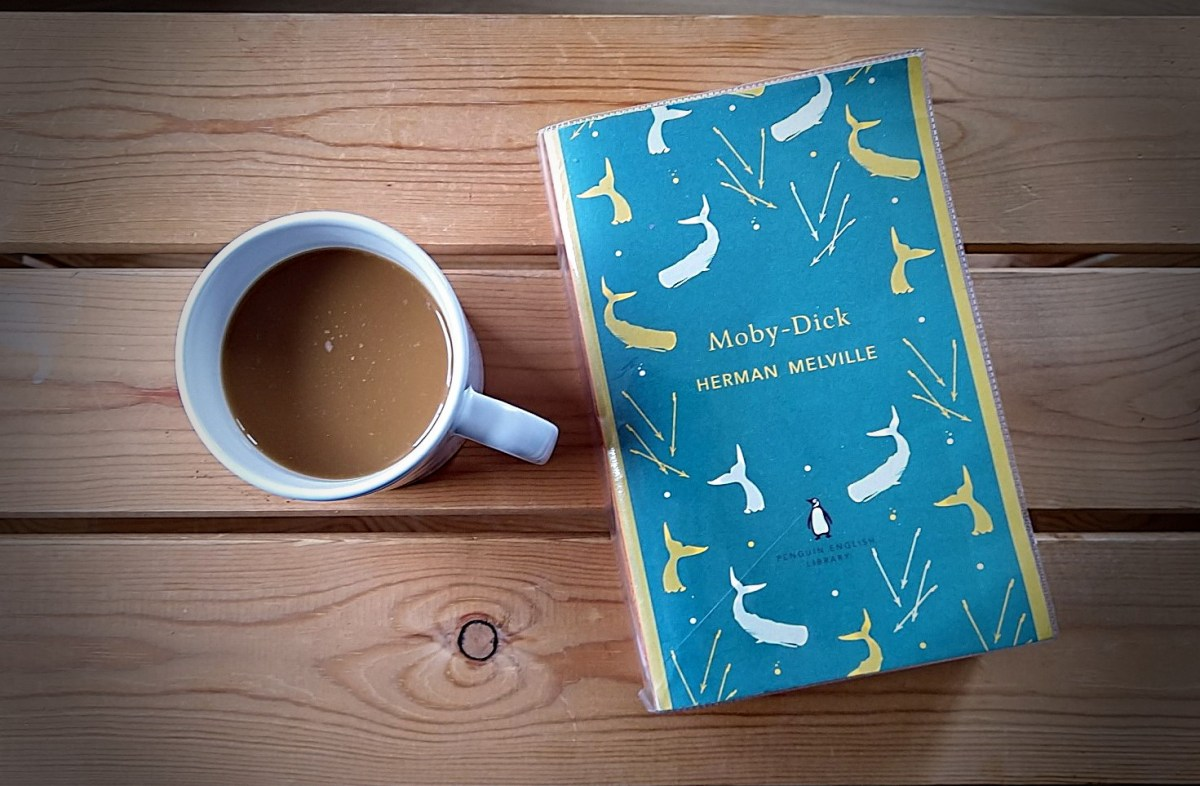 moby dick by herman melville next to a cup of coffee