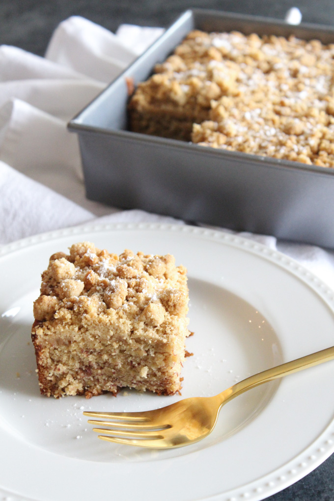 My favorite banana bread recipe transforms into the most delicious crumb cake with the addition of a soft and sweet peanut butter crumb topping.