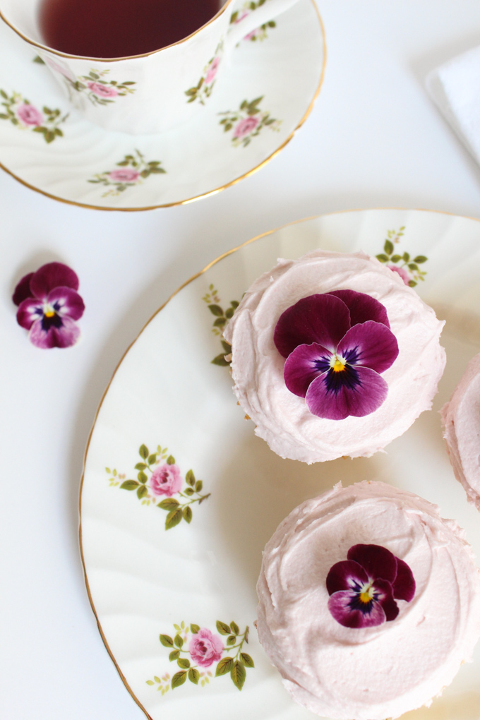 Easy, made-from-scratch lemon cupcakes are divine with raspberry buttercream frosting. Garnished with fresh flowers, they're a perfect springtime treat!