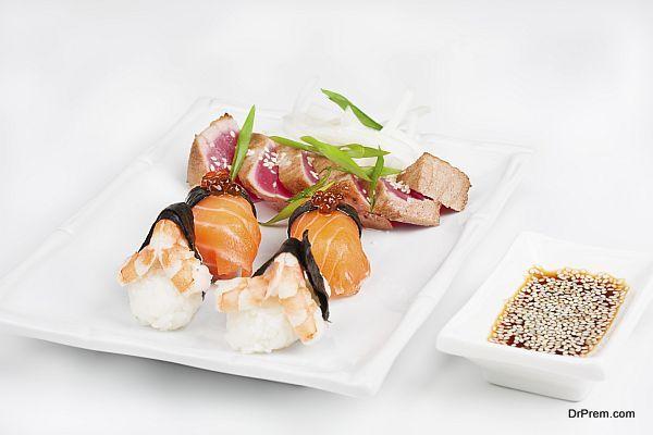 The sashimi plate with shrimps, salmon and tuna