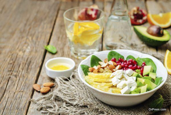 Spinach feta avocado pomegranate orange almond salad with orange