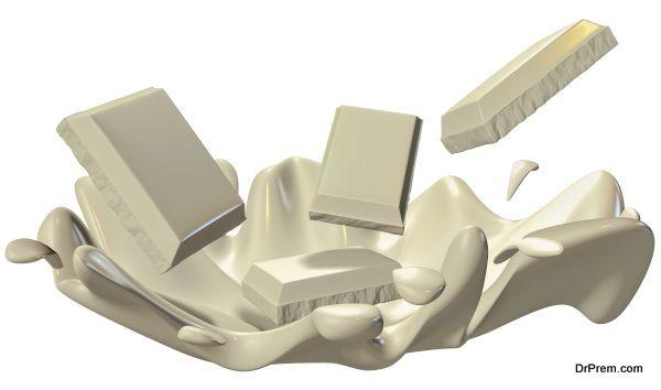 White chocolate splash closeup, isolated on white background.
