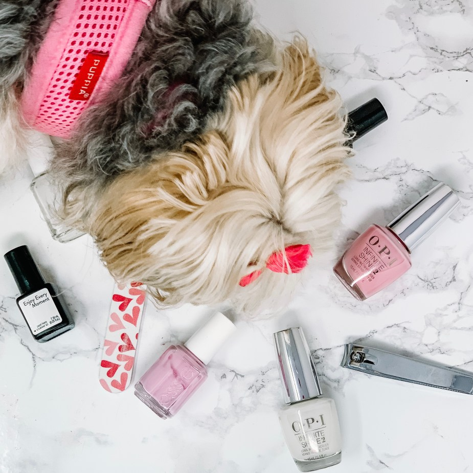 5 Simple Steps For An At Home Spa Night - OPI White Nail Polish, OPI It's A Girl Pink Nail Polish, Essie Pink Nail Polish, Ulta Nail File, Nail Clippers, Sensationail Enjoy Every Moment, and a puppy