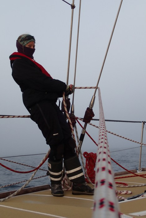 Helen holding the rig up (and trimming a spinnaker).