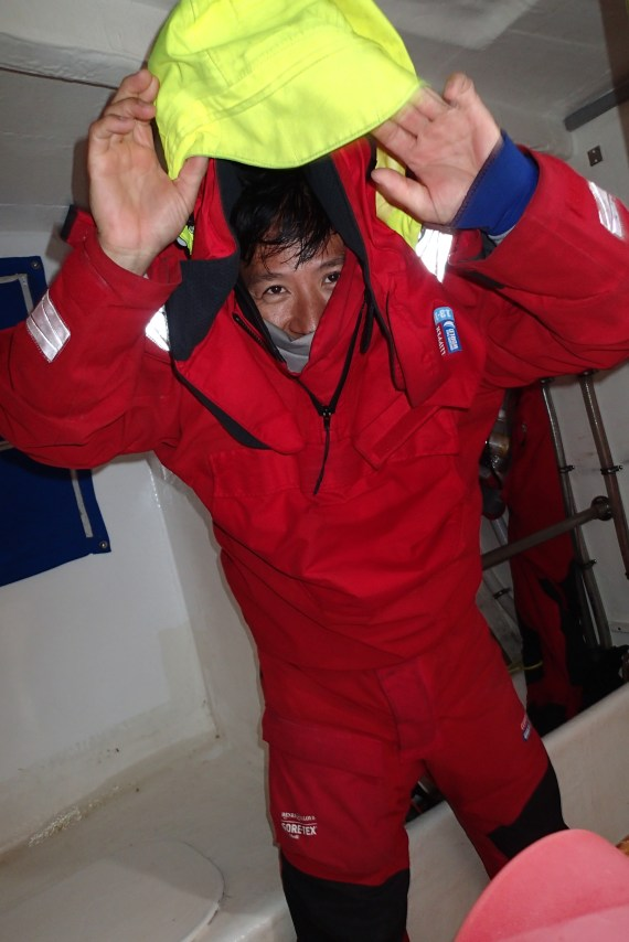 Dr Dan in the eternal struggle to get wet weather gear on.