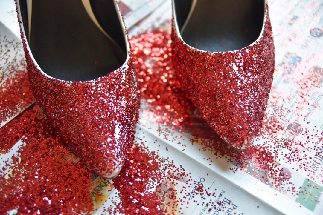 Red glitter shoes on white pumps first layer
